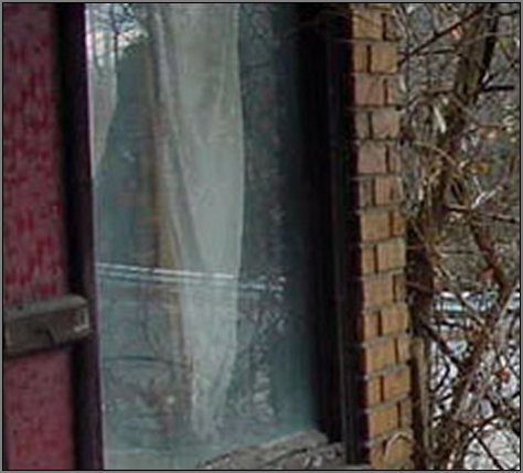 evil ghost spirit in window scary true